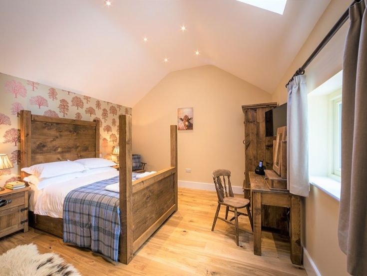 A four poster double bed.  Dog-friendly holiday cottage UK #dogholiday #petfriendly #peakdistrict