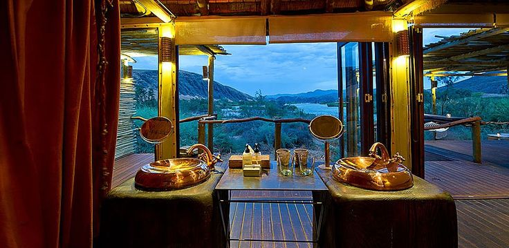Serra Camp, Kunene, Namibia | Wilderness Safaris Cafema twin bathroom amenities with a breathtaking view