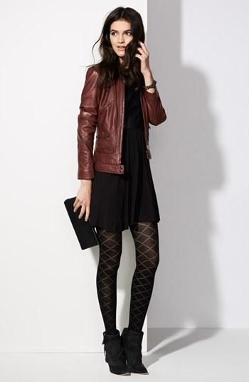 All black + brown leather jacket + patterned stockings + booties