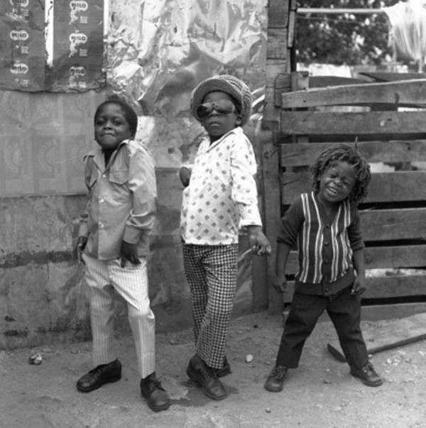 Three Jamaican boys pose for the camera, 1974