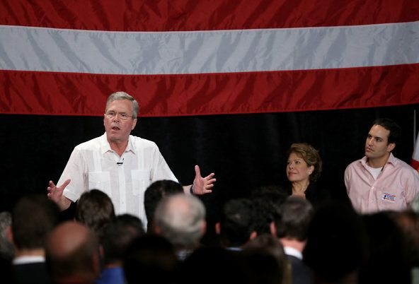 Jeb Bush speaking to supporters in Florida in March with his wife, Columba and son, Jeb, Jr.