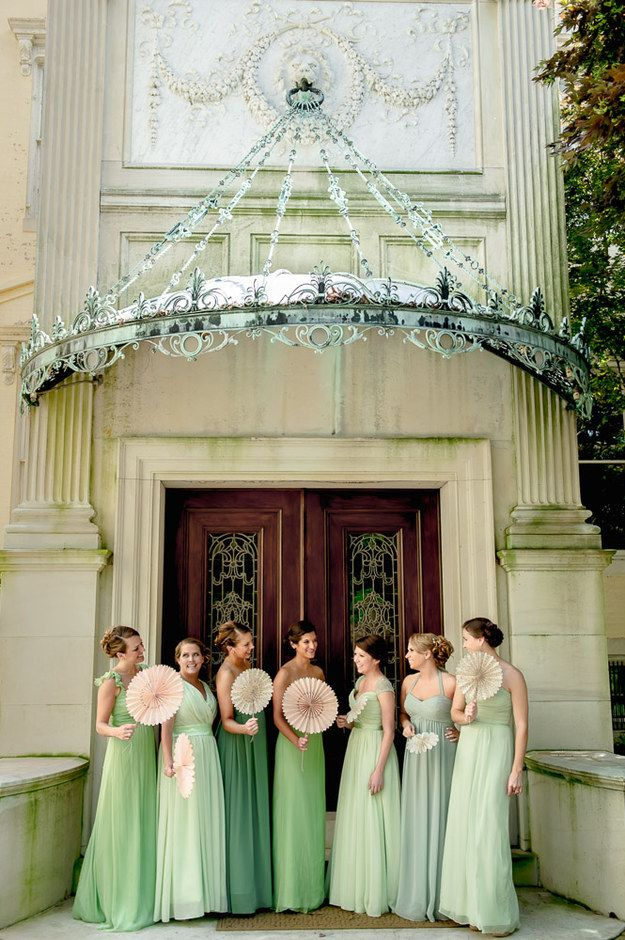 Have bridesmaids carry paper fans instead of bouquets.
