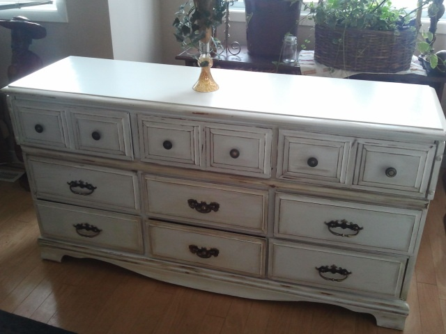 White painted dresser finished with Annie Sloan dark wax for the old world field.