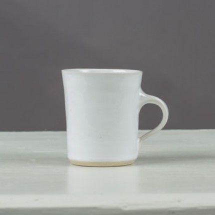 WONKI WARE Small Mug White: A charming handmade coffee mug. We absolutely love these simple coffee mugs which also make a lovely present, and bought as a set, make a unique wedding present. The mugs are a good size for a cup of coffee in the morning to kick start your day. Contemporary in shape and colour make this a very popular item. The mugs are handmade and painted, therefore the colours may vary. This is not a defect in the product merely the artisans working method.
