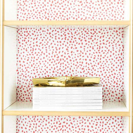 Showcasing a bold pink spot print, this peel-and-stick wallpaper brings regret-free style to any room. Make a statement on an accent wall or your refrigerato...