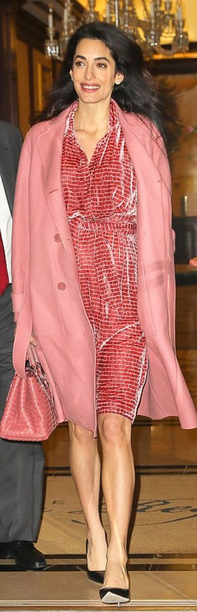 Who made  Amal Clooney's pink woven tote handbag, double coat, and velvet print dress?