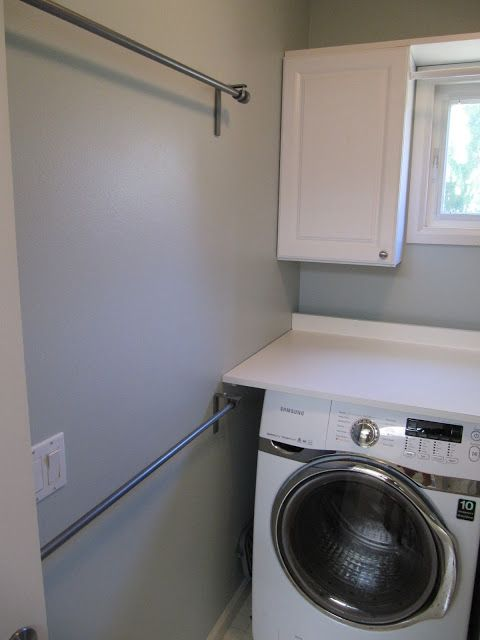 Hang curtain rods in the laundry room to dry damp items