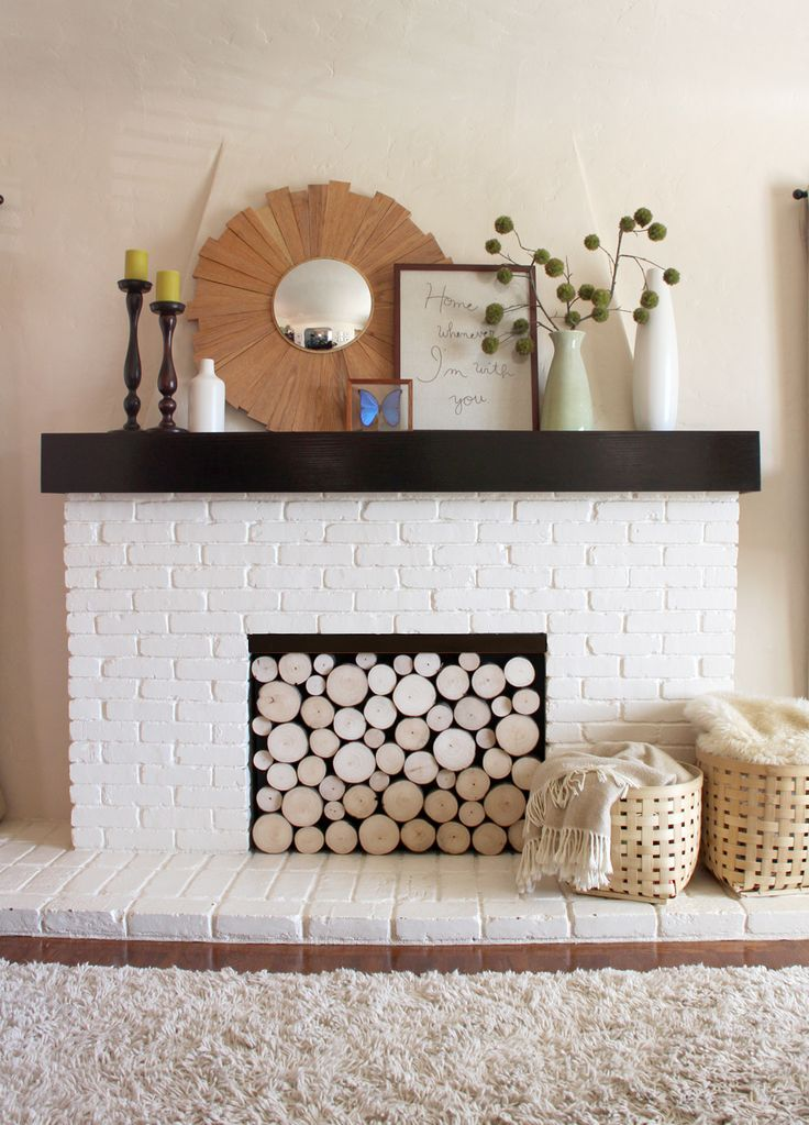 Faux Stacked Log Fireplace Facade - perfect for when the fireplace isn't in use during the warmer months.