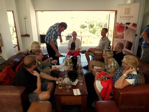 Wayne Gabb with our Swedish guests at the Lomond Tasting Room at Farm 215 - nature retreat & fynbos reserve on 05.01.2013
