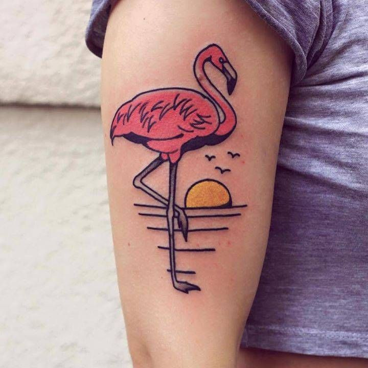 Illustrative flamingo tattoo on the right upper arm.