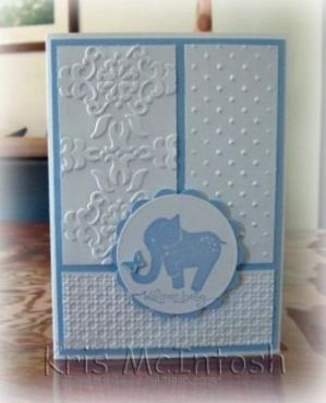 handmade baby card ,,, baby blue and white ... three panels, each with its own embossing folder texture ... like the different dimensions too ... focal point with happy blue elephant ... sweet baby boy card!!