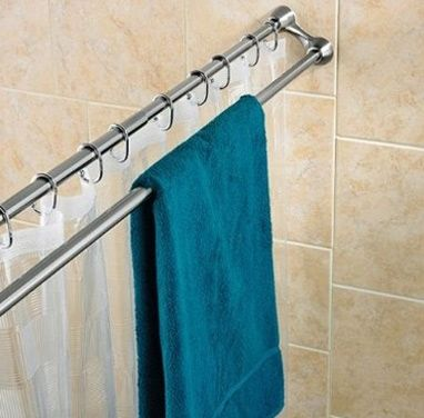 Towels can nestle right outside the shower curtain with a double rod. - This would be great when guests come over and you run out of hanging space in the bathroom!