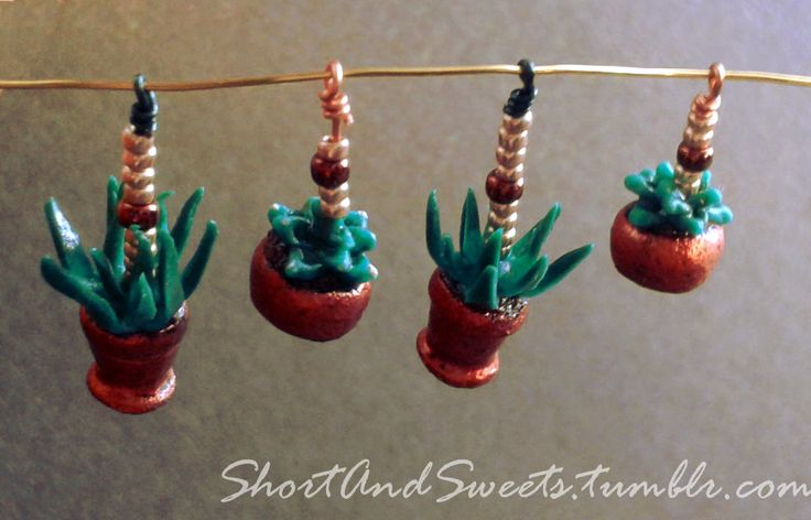 These adorable succulent earrings are half the size of a paperclip including chain. The flatter ones are already taken, but the aloes are available as charms or earrings for US$15 each or US$25 the pair. These guys are made out of polymer clay, not...