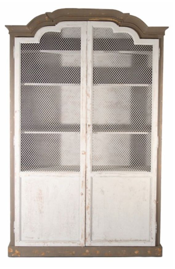 The Benjamin cabinet has a sturdy presence but can add a delicate touch to any room. It features a two tone distressed painted wood finish and chicken wire doors. This cabinet is substantial and provi