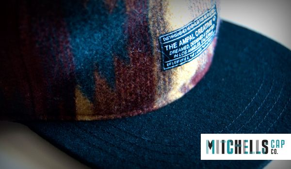 Mens Winter Hats Wholesale: Mens 6 panel flat peak fashion hat with an embroidered fabric label. Warm, earthy and comfy. Perfect for a skate in the early morning.