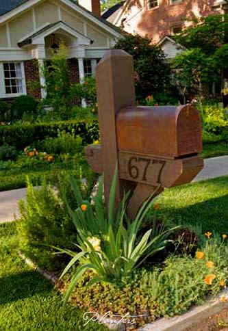 © Planters Garden and Jeremy Smearman. Morningside Atlanta, GA -- Jeremy Smearman, smith and hawken mailbox, copper mailbox, rosemary, bearded iris, California poppy, sedum, Korean boxwood, Tudor bungalow -- Photo is the property of Planters Garden, Jeremy Smearman or is being used under liscense agreement with the photos owner. All Rights Reserved.