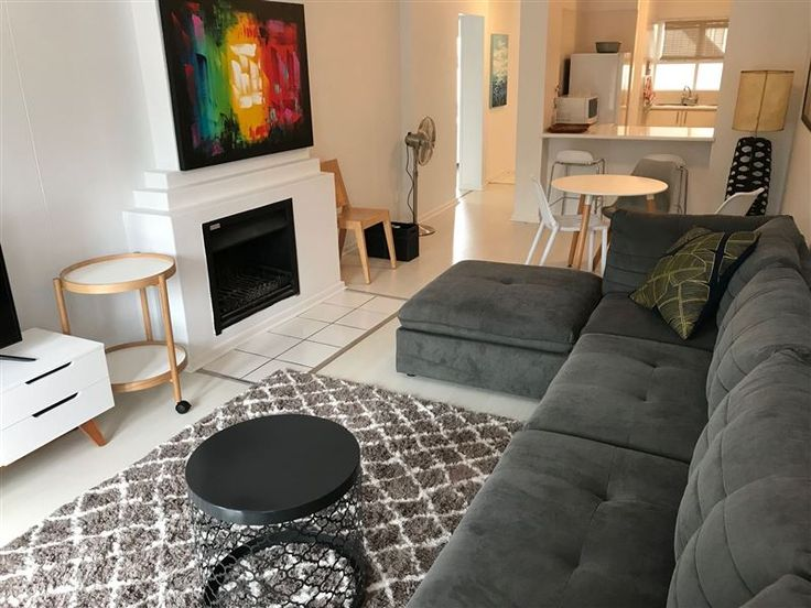 De Waterkant Piazza - Welcome to De Waterkant Piazza. This is a 2 bedroom, 2 bathroom apartment with a separate lounge/dining area and open-plan kitchen with a breakfast counter. The main bedroom and lounge opens to a small ... #weekendgetaways #dewaterkant #capetowncentral #southafrica