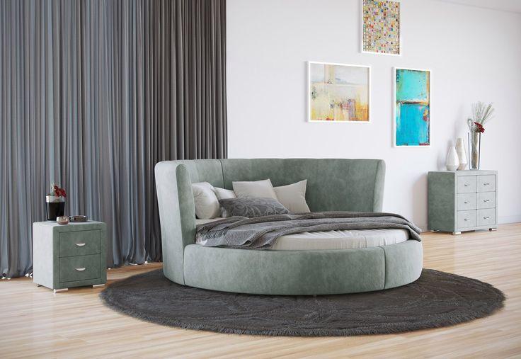 Как гармонично вписать в интерьер стильную круглую кровать? Вот несколько советов: много пространства, круглый элемент дизайна, например, ковёр. Комод и прикроватная тумбочка сделают интерьер наполненным и удобным. Светлый оттенок мебели и тканевая обивка создадут ощущение легкости. На фото: кровать Luna, комод Orma Soft 2, тумба Orma Soft 2. Обивка мебели выполнена из мебельной ткани Велсофт, цвет ментоловый. https://ormatek.com/catalog/bed/kruglye-krovati/