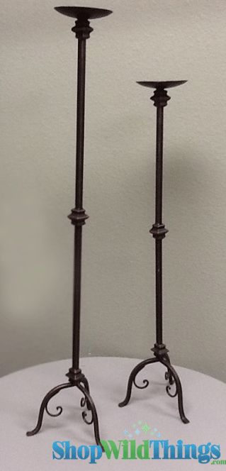 """Only 1 set available.  This lovely set of Antique Bronze Candle Holders are 7"""" in diameter and measure 33.25"""" tall and 39.25"""" tall.  Each plate is 4.75"""" in diameter with a large spike to hold your pill"""