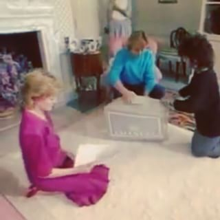 06 October 1985: A rare footage show Princess Diana sitting in the ground at the living room in Kensington Palace. She was meeting her designers; David and Elizabeth Emanuel, who brought a box filled with fabrics for Diana to view and select new wardrobe for her next tours. She is seen viewing the design skitches.
