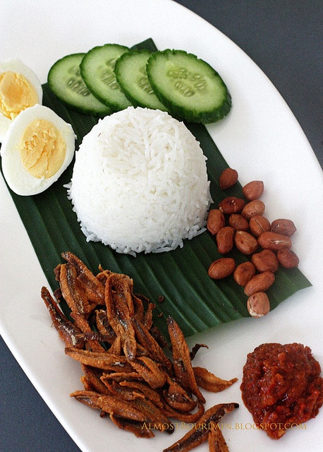 Coconut rice with a variety of dishes (Nasi lemak), Malaysia
