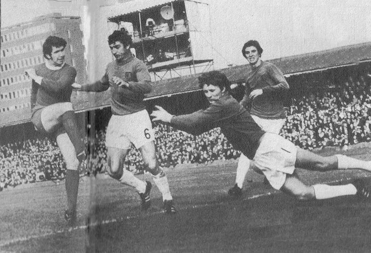 24th October 1970. Liverpool right back Chris Lawler pops up in the Ipswich Town penalty area but goalkeeper Laurie Sivell does enough to put him off, at Portman Road.