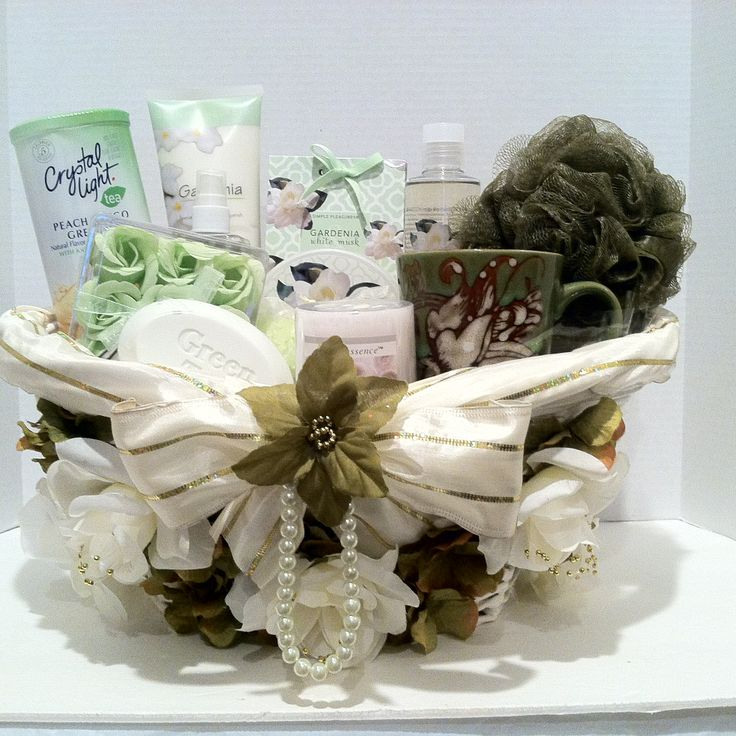 "(Spa Gift Basket) All the essential you need to feel fabulous right here gardenia lover's Vera-Mae Collection this is just for you. Relax and enjoy this fabulous gift basket which includes, candle, soap rose petals, sponge, body spray, shower gel, body butter, (2) bath crystal, body bar, cup, body lotion, crystal light tea peach mango.  ""Item Sold"""