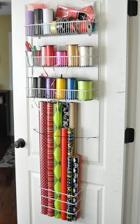 """A solution to the """"how do I store my gift wrap"""" dilemma...      on the back of a door!   I used to store my g..."""