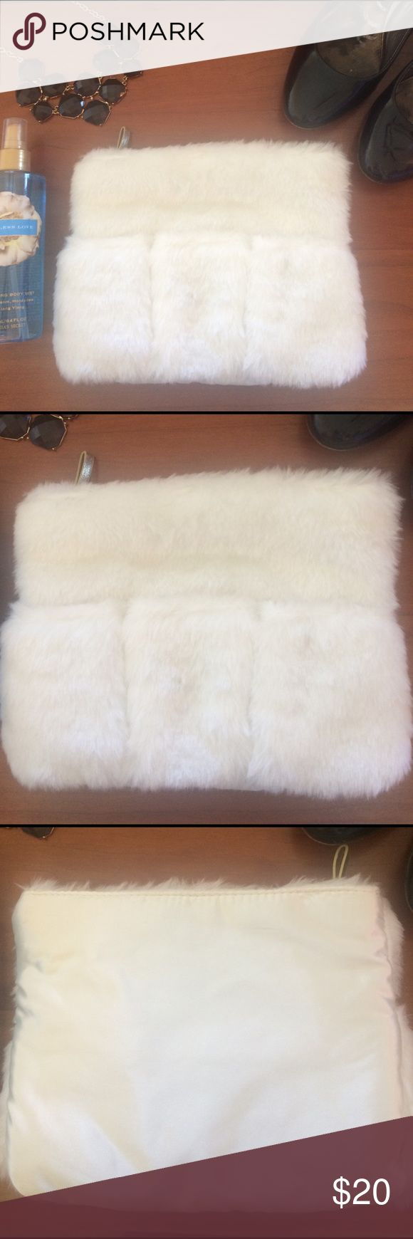 🆕Victoria's Secret Fur White Clutch Bag Beauty Brand New Victoria's Secret Beauty Faux Fur Clutch Makeup Bag Purse White color Has three pouches on front (were supposed to put body spray or lotions but you can put whatever in them) Gold Detail  Zipper top Inside & back are a stain material   Please ask any questions  💲Open To Offers💲 🚫No Trades🚫 📦Ask About Bundle Discounts💰 Victoria's Secret Bags Clutches & Wristlets