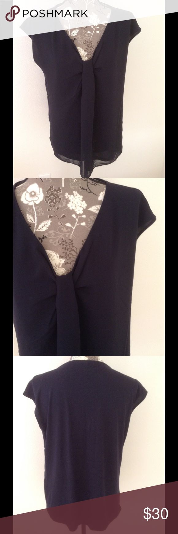 Black short sleeve top with knotted front Back short sleeve top with v-neck and knot front design. Front body 100% polyester, back body 60 % cotton/40% modal, lining 100% polyester. Machine wash cold. Ann Taylor Tops Blouses