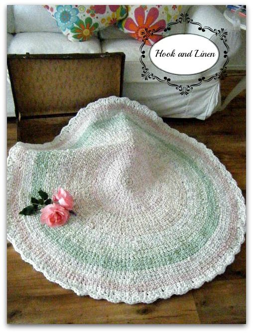 A pretty rag rug with a  blend of Pinks and Green and white scalloped edge. hand made crocheted rag rug ***