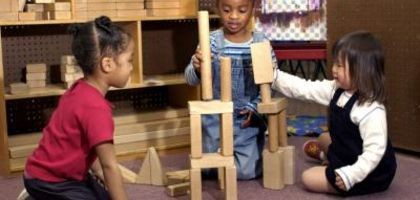 Children with wooden blocks