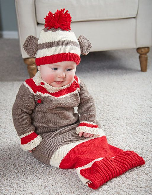 "Knitting Pattern for Sock Monkey Onesie and Hat - The Cheyenne Monkey Baby Set includes instructions for hat and a sleep sack with a buttoned bottom and buttons at the shoulders for easy dressing. Sizes 7¼ (18¾ , 19¾ )"" chest circumference. Designed by Jessica Anderson."