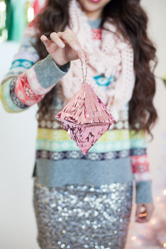 A tiny replica of our ever so popular crystal octahedron piñata. Perfect for your Christmas tree or any place you want to add some sparkle! Hand