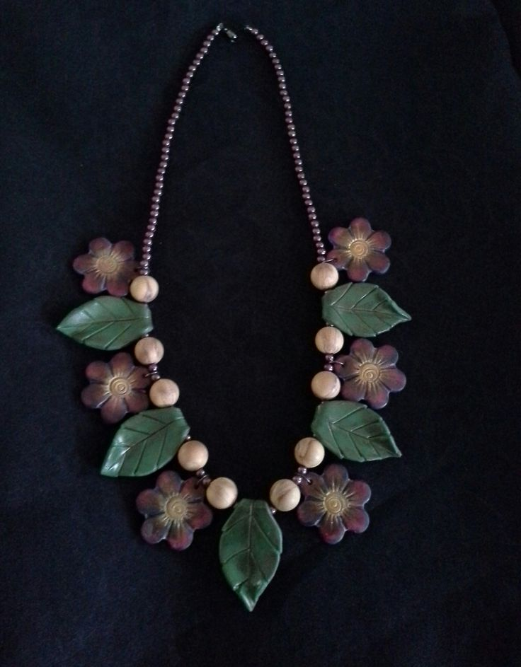Necklace made from polymer clay, colored with pastels and pencils.