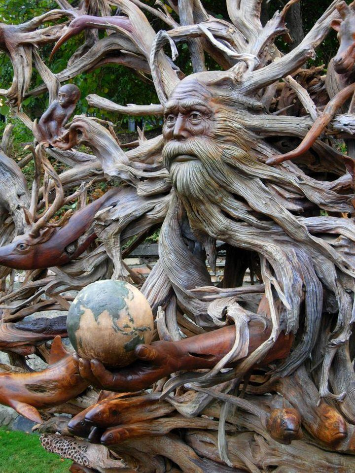 Meticulously Carved Wooden Sculpture of Man and Nature