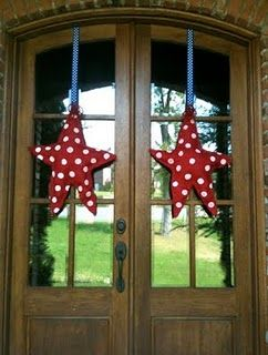red polka dot stars; they would be pretty in white and silver, too, standing in boughs with mercury glass