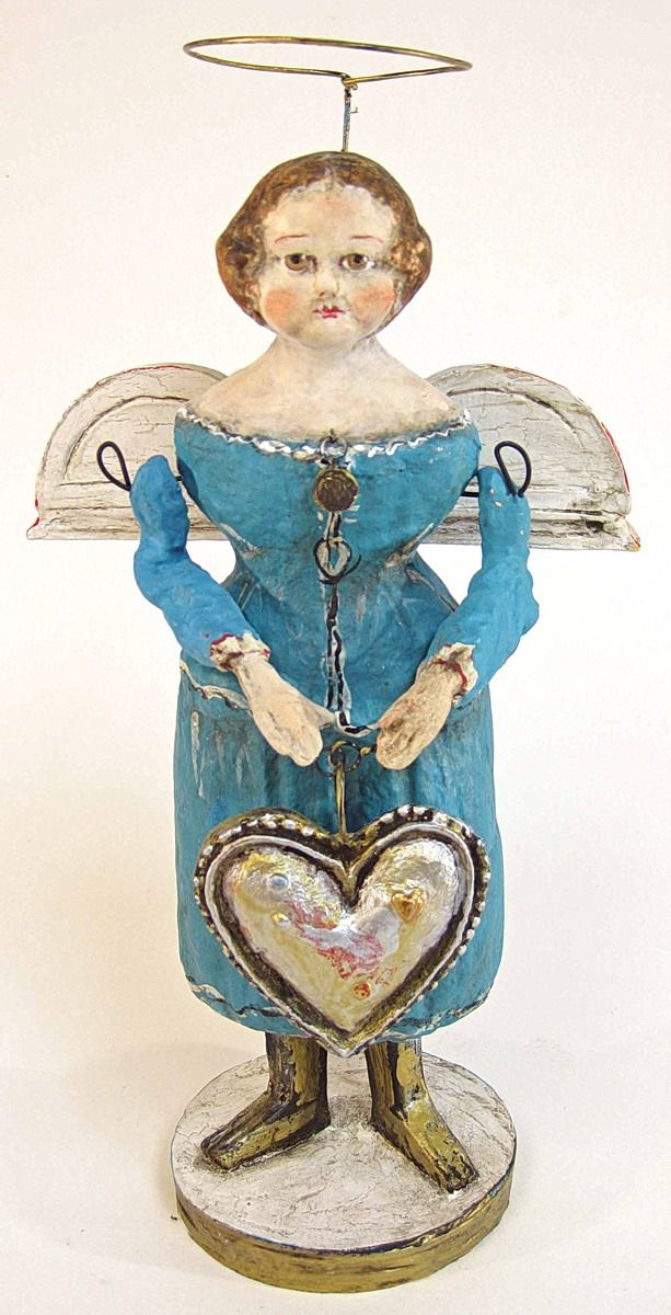 Angel with a Big Heart...This is from the Debbee Thebault collection......I went to HS with her, she was Debbee Baxter back then. Love her stuff!