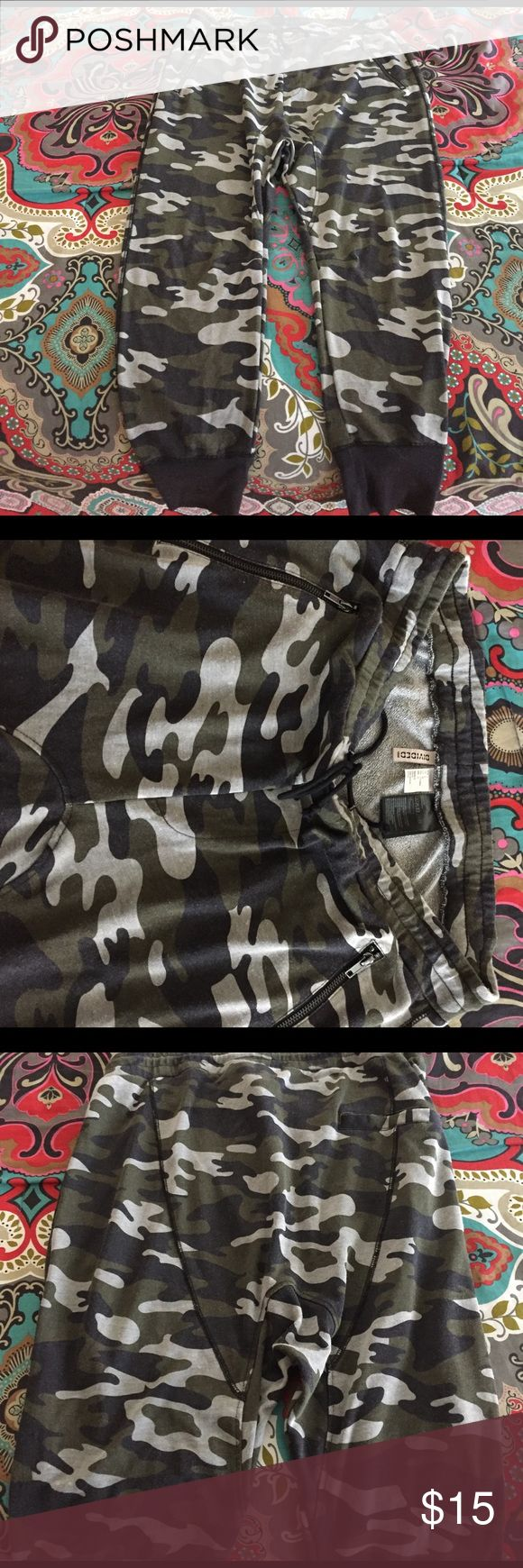 Drop crotch joggers Camoflaaaahgeeee!!  Super comfortable drop crotch joggers from H&M.  2 angled, zip pockets, drawstring waist, cuffed ankles.  Very soft material.  55% polyester, 45% cotton H&M Pants Track Pants & Joggers