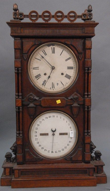 Walnut Victorian Seth Thomas double dial calendar clock with carved lion heads and acorn finials. - Realized Price: $4,248.00