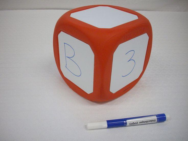 """Titre: Write-on & wipe-off die.  Cote: JEU 2138 Description:  Comprend 1 dé, 1 crayon effaçable à sec de marque Pentel.  """"Avec ces superbes articles de manipulation, créez vos propres fractions, opérations et autres dés spécialisés. À utiliser avec des marqueurs à essuyage à sec ou des aimants.""""--Site Web du fournisseur.   Format:  1 dé ; 12 cm."""