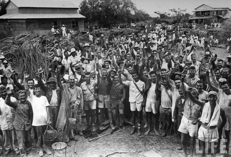 US POW survivors of the infamous Bataan Death March who were freed from Cabanatuan prison camp by US Army Rangers and Filipino guerillas. Cabanatuan, Philippine Islands. 30 January 1945