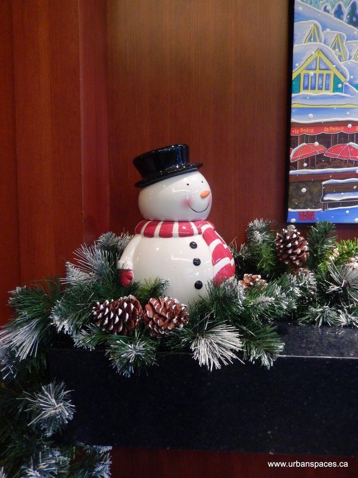 This little ceramic snowman was nestled in a pine cone garland on a mantle at The Crystal Lodge and Suites in Whistler, BC, Canada