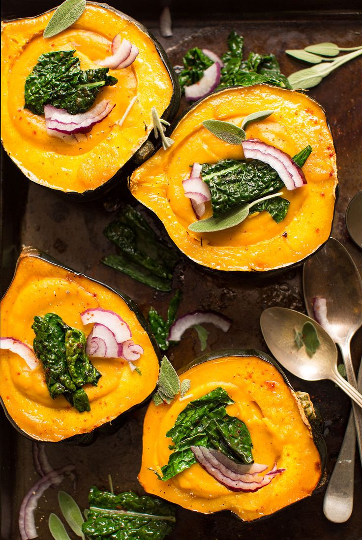 10-ingredient creamy fall soup with carrots and butternut squash in roasted acorn squash bowls. The ultimate healthy comfort food this fall and winter.