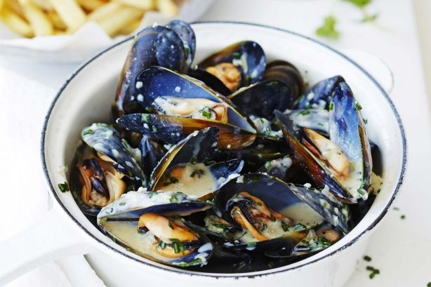 Serve creamy garlic mussels with crunchy oven fries for a complete family meal.