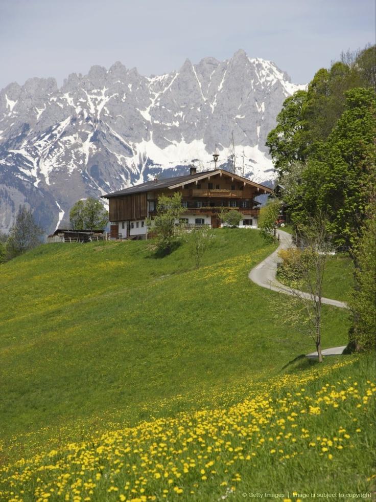Scenic view of farmhouse and mountains, view to Wilder Kaiser, Kitzbuhel, Tyrol, Austria