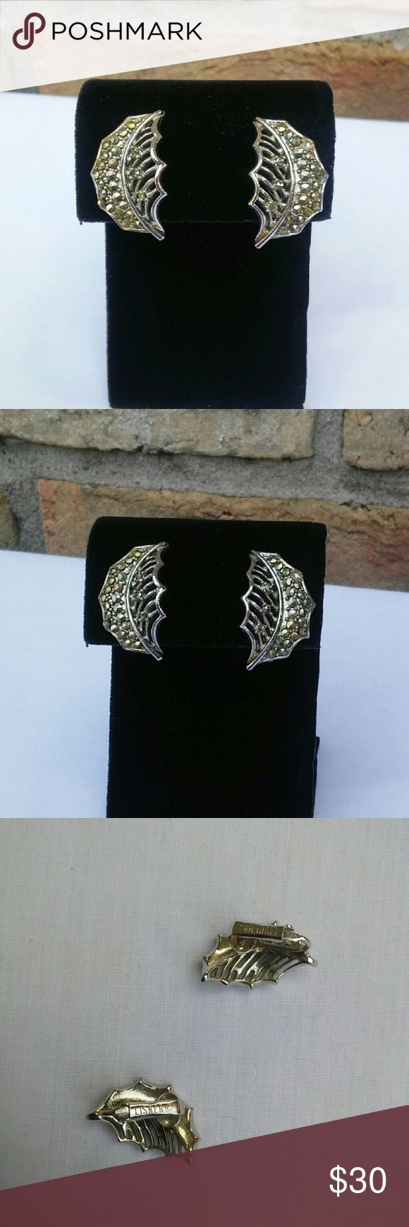 Vintage Late 50s Lisner Marcasite Leaf Earrings These beautiful leaf earrings by Loaner are a hard to find beauty. Studded with open set steel cut marcasite, they shine and sparkle. Sturdy clip backs in perfect working condition. No flaws I can find. Marked Lisner Vintage Jewelry Earrings