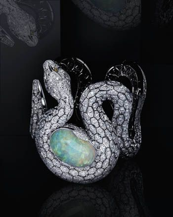 Cartier Amoni Python Diamond Watch.   Diamonds and a 34 carat opal 'egg' which conceals the watch face.
