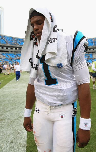 Cam Newton Photos - Cam Newton #1 walks off the field after loosing 30-23 against the Green Bay Packers at Bank of America Stadium on September 18, 2011 in Charlotte, North Carolina. - Green Bay Packers v Carolina Panthers
