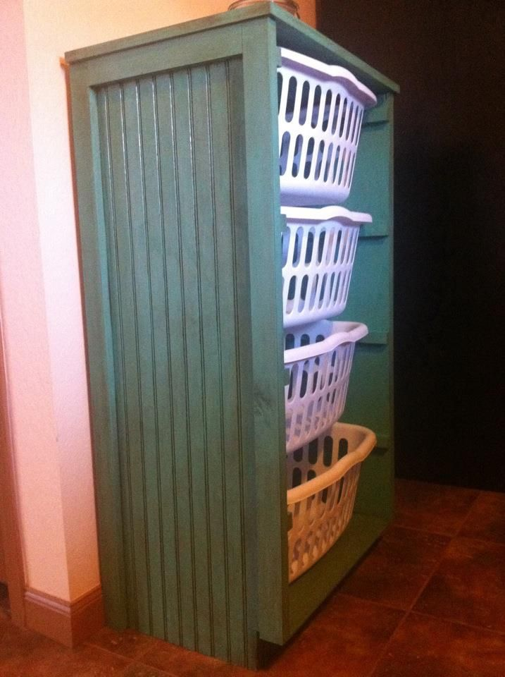 Laundry basket dresser.  Clears the floor and makes for a much tidier laundry room!  My Dad made this for me.  Love!!!